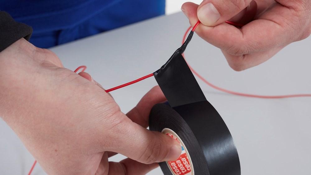 tesa-4163-multipurpose-soft-pvc-premium-tape-black-black-step3of4-ap.jpg